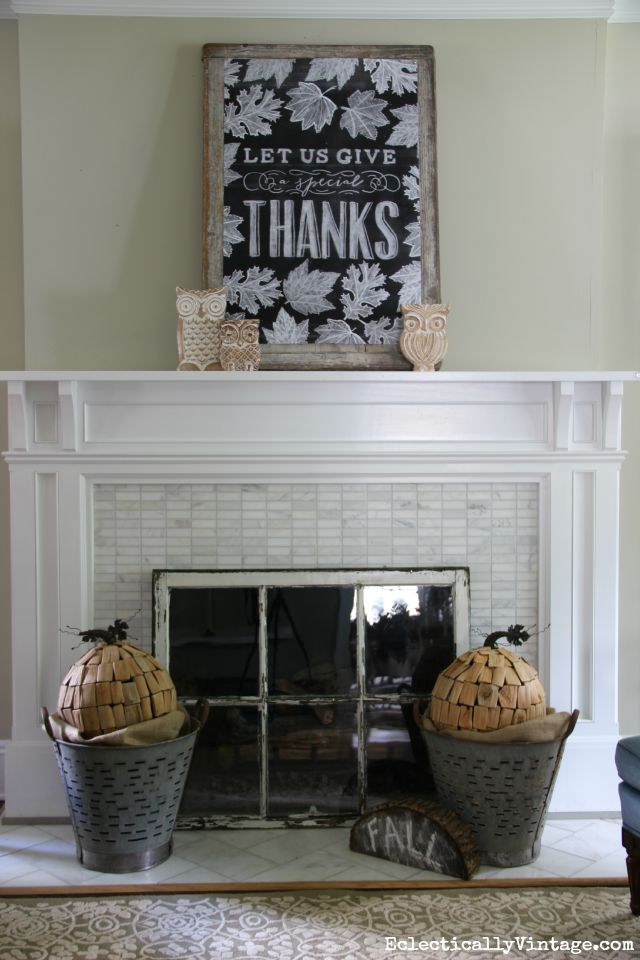 Love this neutral fall mantel, the vintage olive buckets holding driftwood pumpkins and that huge chalkboard printable kellyelko.com