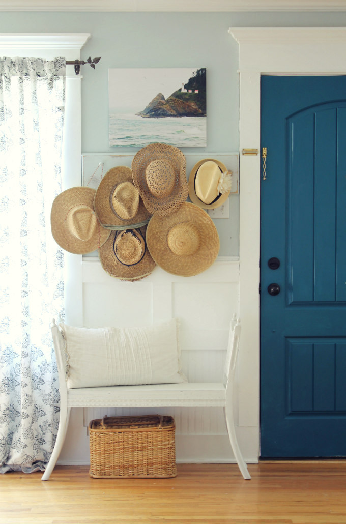 Cottage home tour - love the collection of hats kellyelko.com