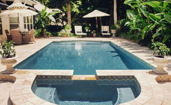 Tropical oasis backyard with beautiful pool