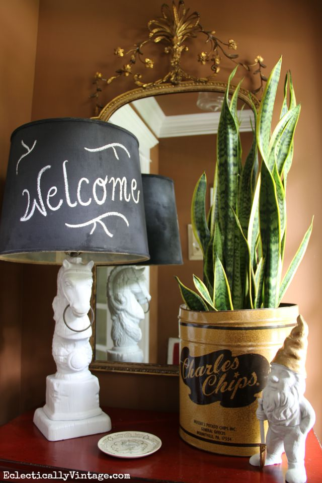 Love the mix of antique and vintage finds - the old Charles Chips container is such a fun planter kellyelko.com