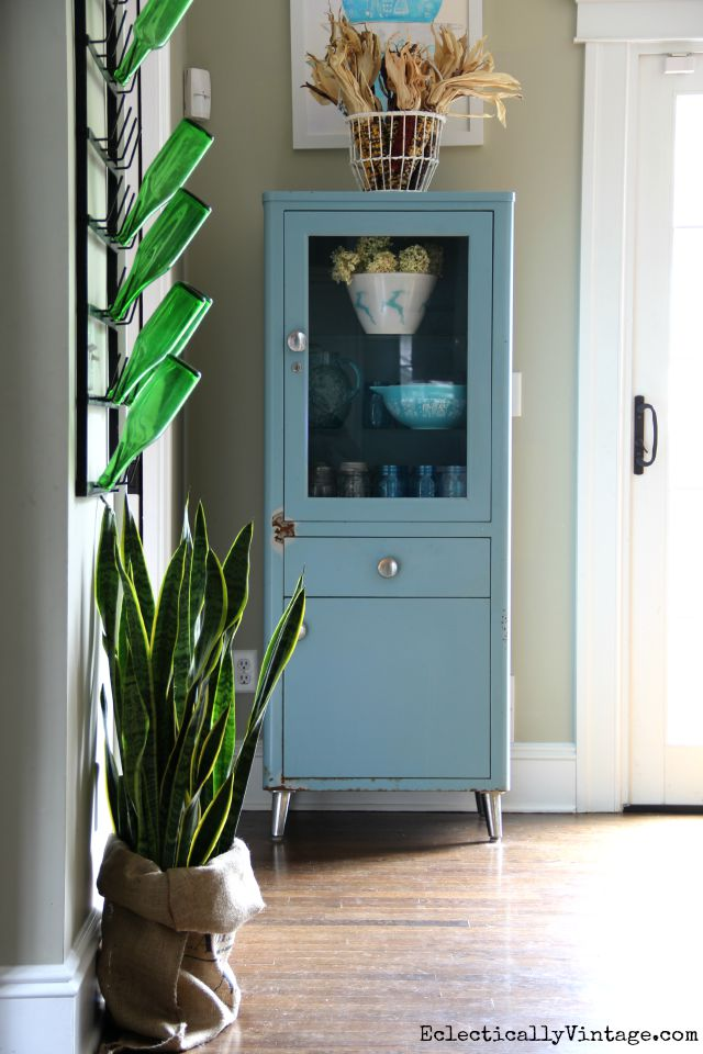 Love this vintage blue medical cabinet in the kitchen kellyelko.com