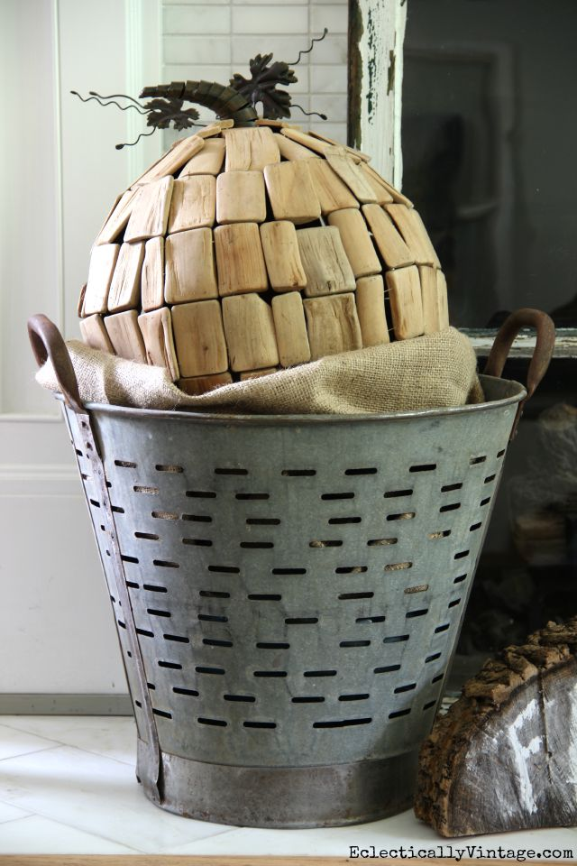 Vintage olive bucket with driftwood pumpkin for fall kellyelko.com