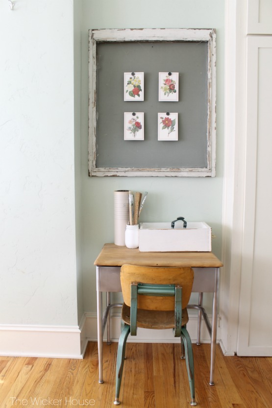 Cute little vintage school desk and love the old screen window used to display art
