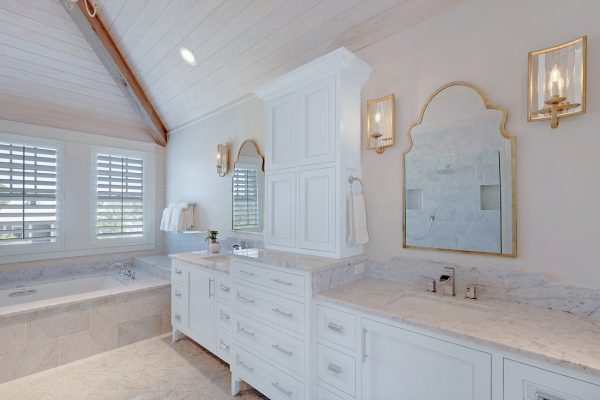 Carrara marble master bathroom - love the plank wood ceiling and the gold accents - part of this full coastal home tour kellyelko.com