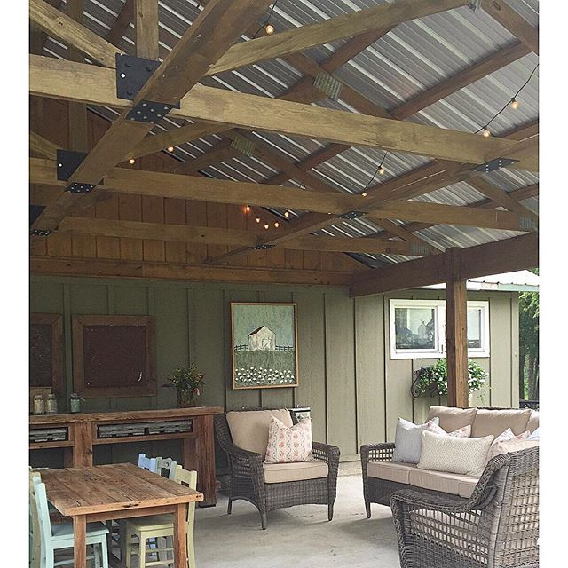 Covered farmhouse porch - love the metal room and the exposed beams kellyelko.com