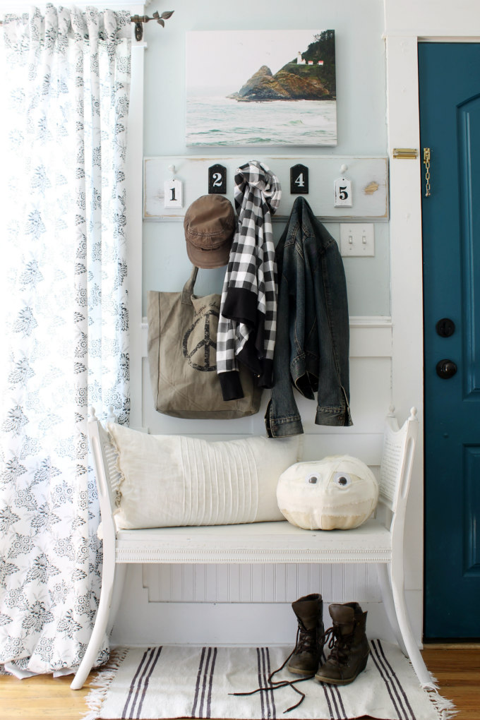 Love the numbered coat rack in this entry and the blue front door kellyelko.com