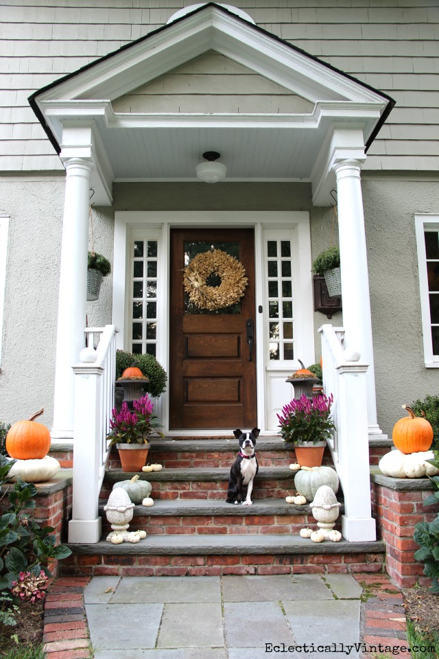 10 Beautiful Fall Porches - love the flowers and stacked pumpkins kellyelko.com #fall #fallporch #falldecor #falldecorating #mums #pumpkins #porch #frontporch #curbappeal #autummdecor #autummporch