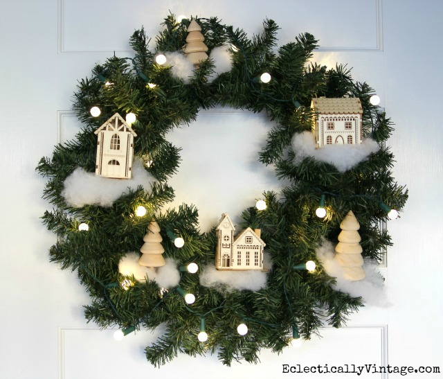 Love this DIY winter village wreath kellyelko.com #christmas #diychristmas #christmascrafts #crafty #wintervillage #christmaswreath #christmasdecor #kellyelko