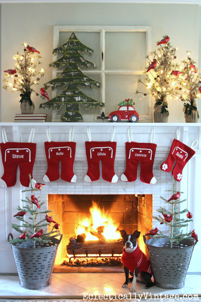 Love this whimsical mantel with long john stockings! The red car and tree theme is so festive! Tons of creative Christmas decorating ideas kellyelko.com