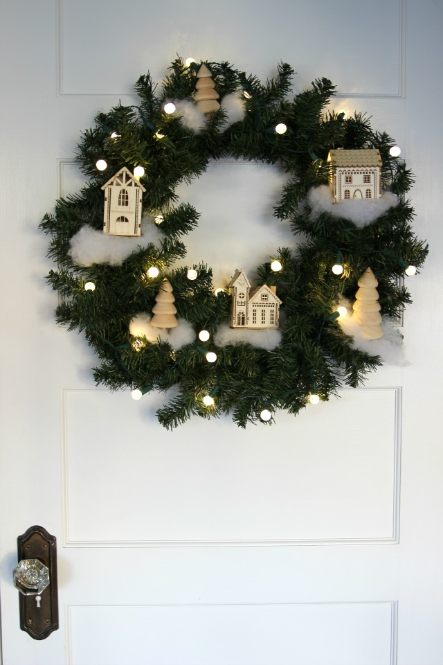 See how to make this cute Christmas village wreath kellyelko.com #christmas #diychristmas #christmasdecor #vintagechristmas #christmaswreath