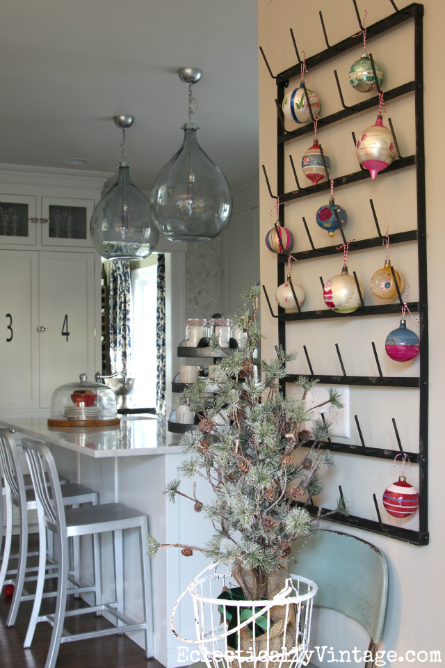 A wall mounted bottle drying rack makes a fun Christmas ornament display kellyelko.com
