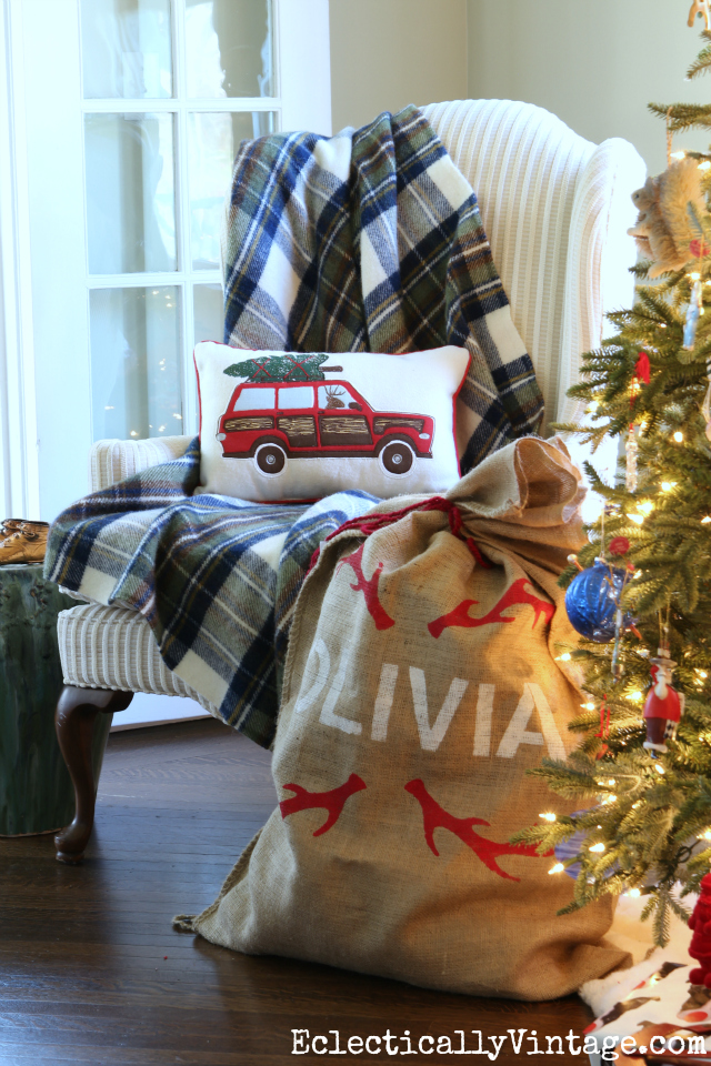 Cozy plaid throw and Christmas car pillow are fun by the tree kellyelko.com
