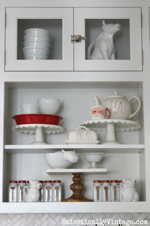Christmas kitchen shelves - love the cake stand collection and the touches of red kellyelko.com