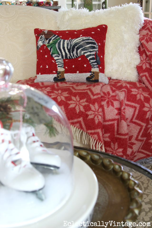 Love the huge fluffy white pillow and the whimsical zebra wearing boots pillow for Christmas kellyelko.com