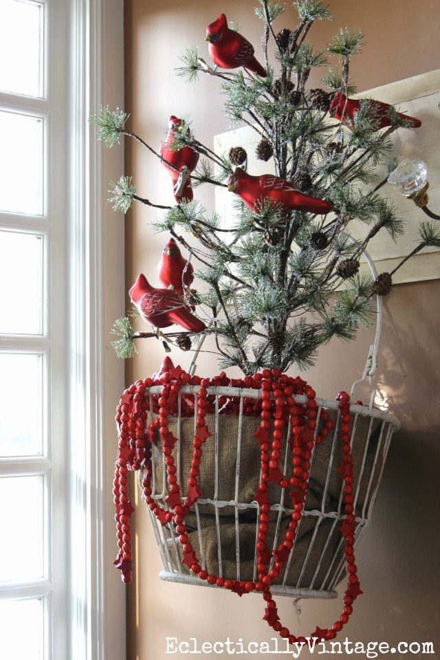 Beautiful little tree decorated with a flock of red cardinal ornaments kellyelko.com #christmastree #christmasdecor #christmasdecorating #farmhousechristmas #christmasornaments #cardinals #kellyelko