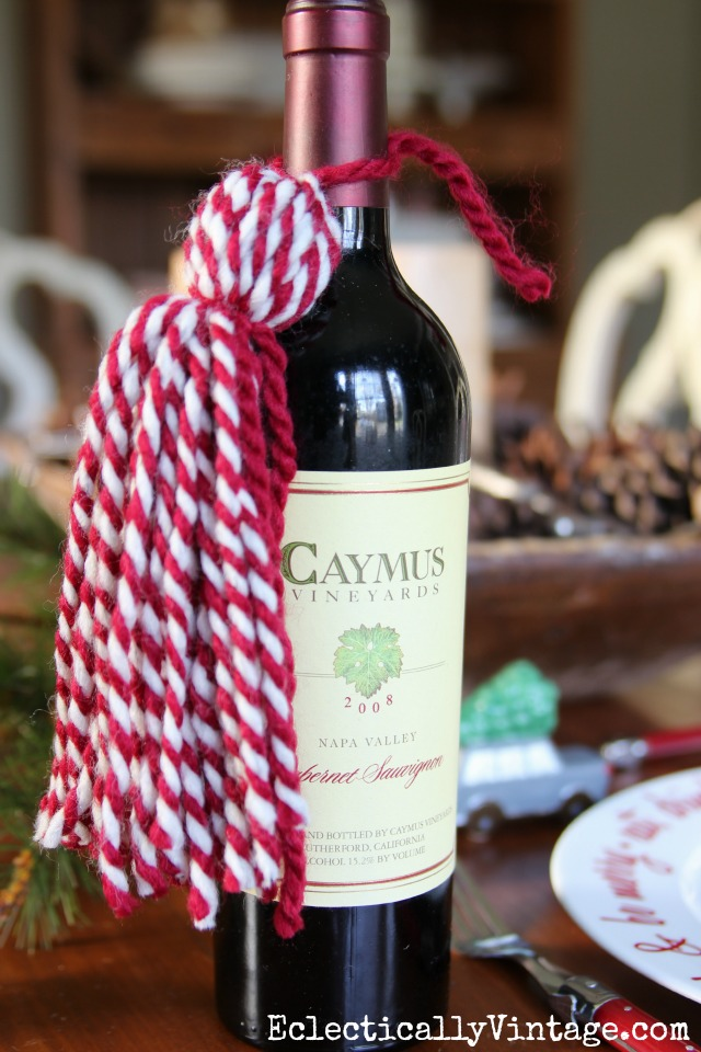 DIY Yarn Tassels - love them tied to a bottle of wine for a fun hostess gift! kellyelko.com