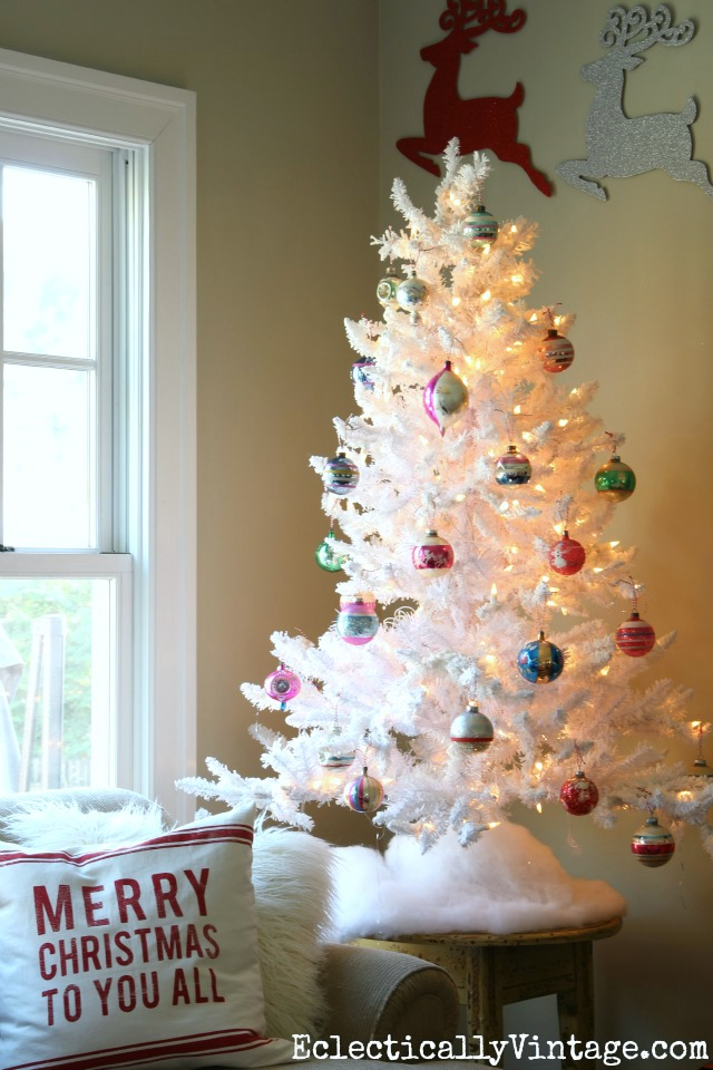 Love the flocked white Christmas tree with vintage ornaments kellyelko.com