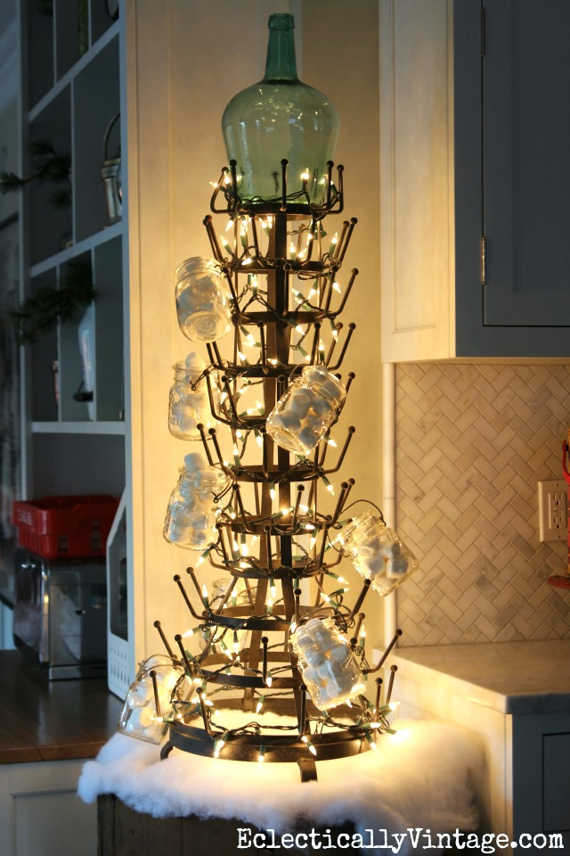 Creative Christmas Decorating Ideas - love this wine bottle holder turned Christmas tree kellyelko.com