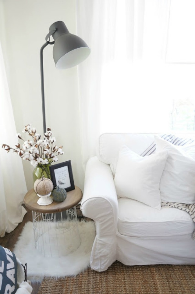 Love the industrial floor lamp and the white sofas kellyelko.com