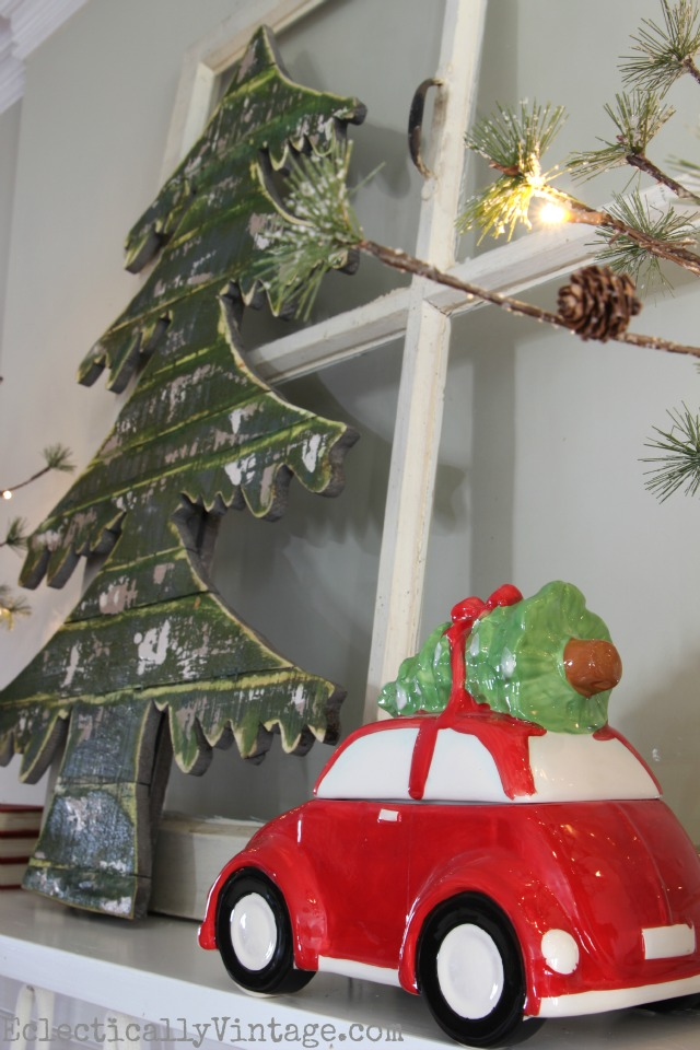 Red car hauling a tree - what a fun Christmas mantel! kellyelko.com