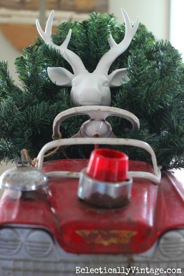 Deer driving red car carrying Christmas tree - watch out! kellyelko.com