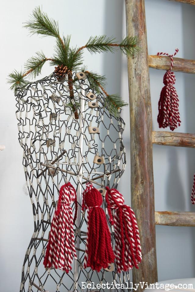 Love this vintage dress form with a few DIY yarn tassels kellyelko.com