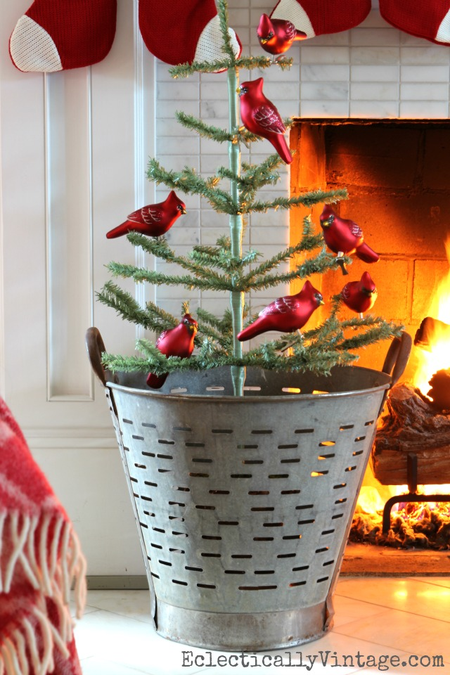 Vintage olive bucket with Christmas tree - love the red cardinal ornaments kellyelko.com