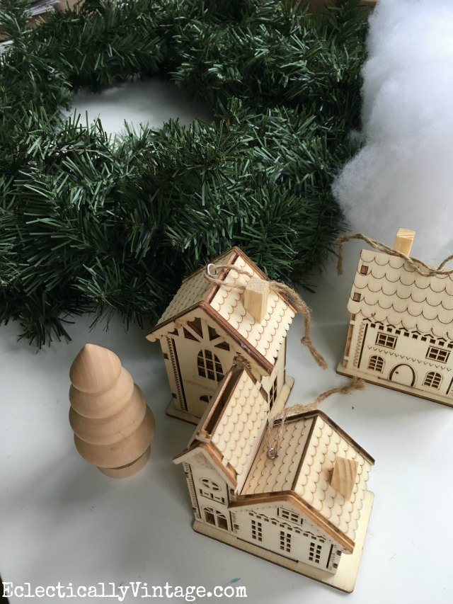 Make a winter village wreath with these cute wood ornaments kellyelko.com