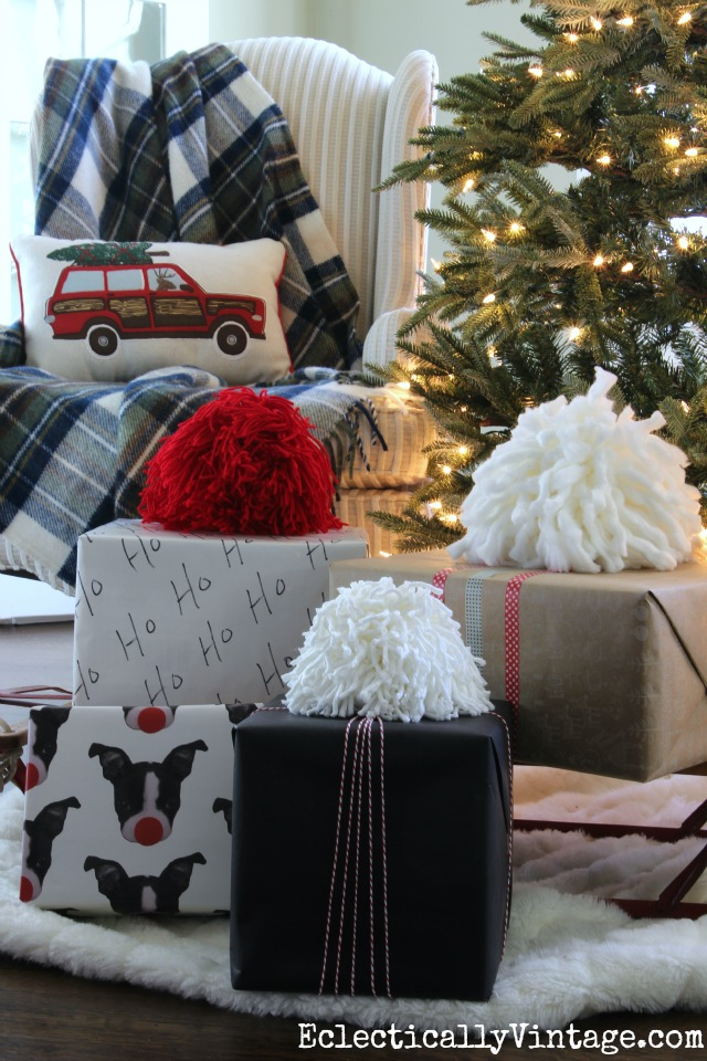 See how to make these huge pom poms! They are so fun and make the perfect gift toppers! kellyelko.com
