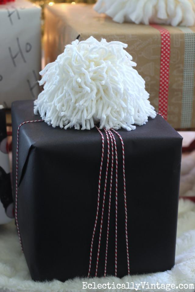 How to make a GIANT pom pom! Such a festive gift topper! kellyelko.com