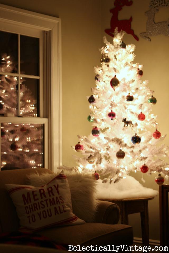 White flocked Christmas tree with vintage Shiny Brites kellyelko.com