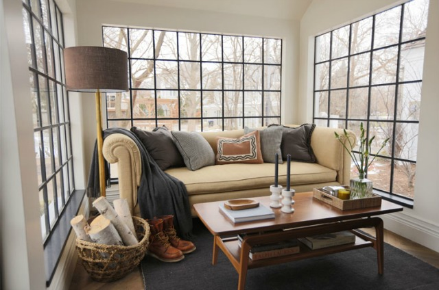 Love the black window mullions in this cozy sunroom kellyelko.com