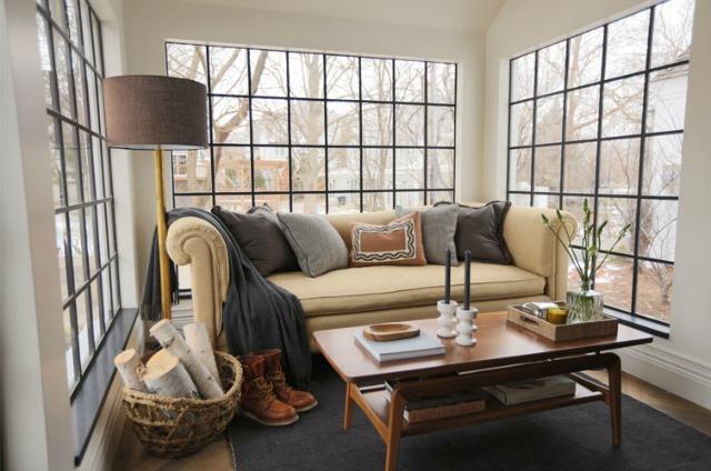 Love the black window mullions in this cozy sunroom kellyelko.com