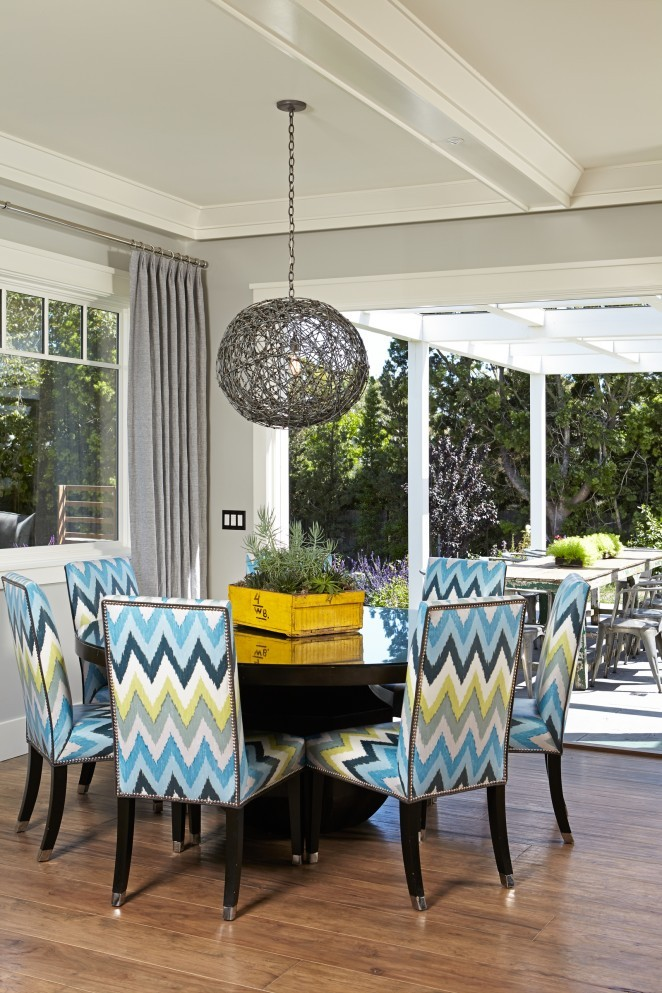 Love the colorful chevron chairs and that fun orb light fixture kellyelko.com