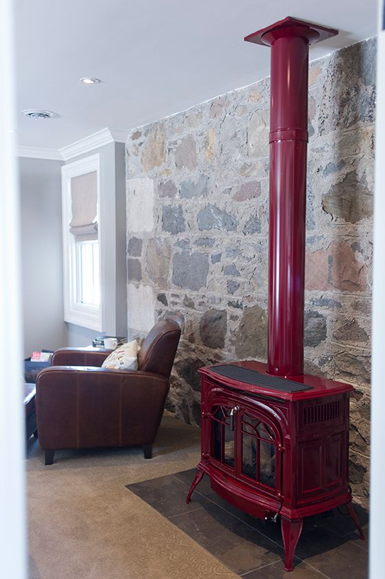 Charming red wood burning stove in this stone walled farmhouse kellyelko.com