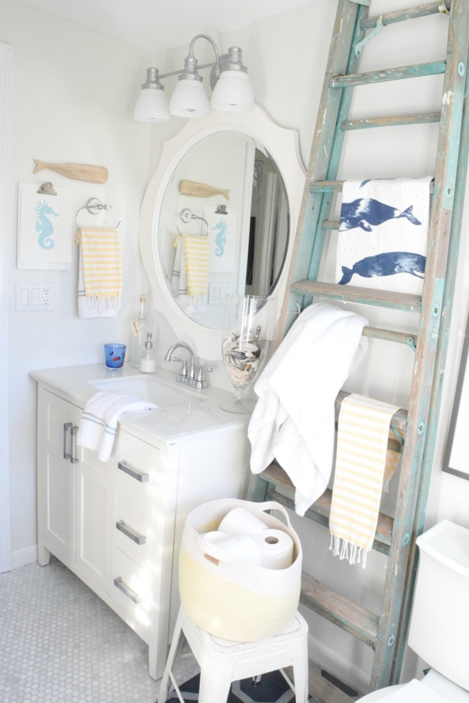 Nautical bathroom with old blue ladder towel holder kellyelko.com
