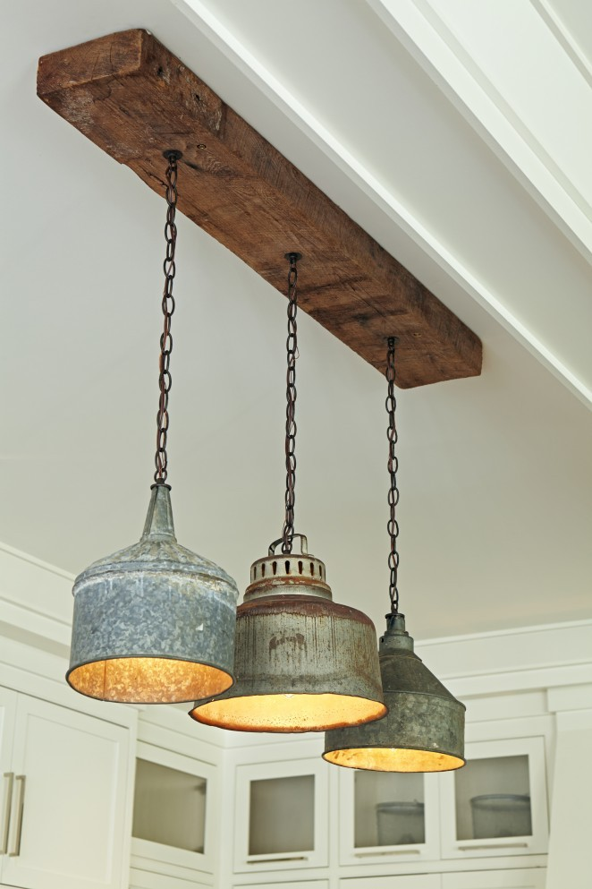 Salvaged tractor funnel chandelier - love the rustic wood kellyelko.com