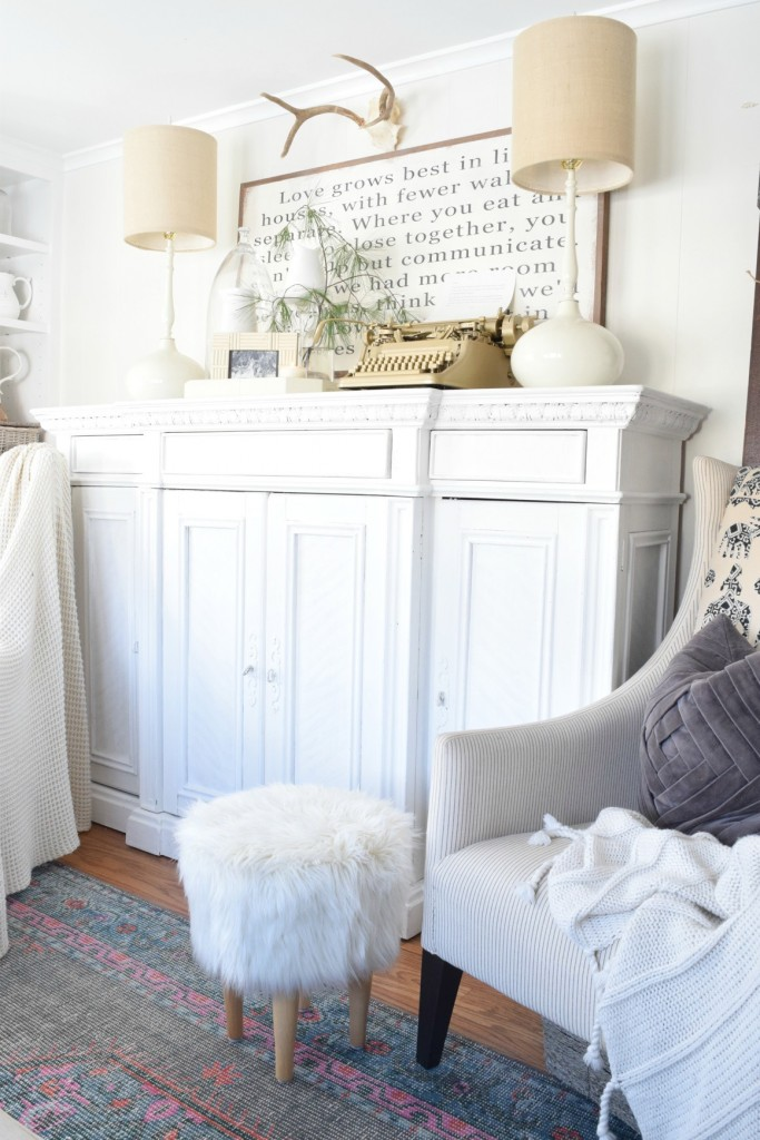White painted cabinet - love the pair of matching white lamps and furry stool kellyelko.com