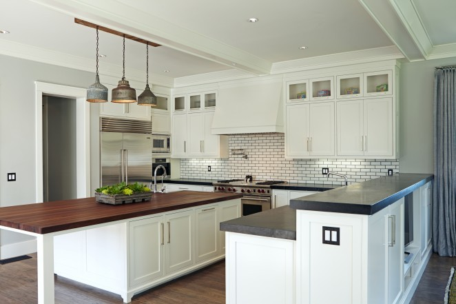 Gorgeous white kitchen with subway tile and black grout and look at that amazing vintage light fixture kellyelko.com