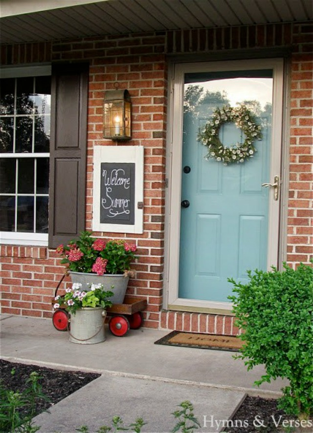 Summer front porch - love the blue door and the old wagon filled with flowers kellyelko.com