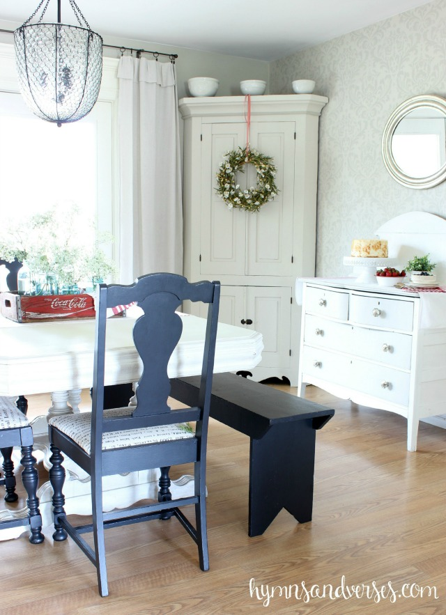Love this eclectic dining room with painted furniture, blue chairs and old bench kellyelko.com