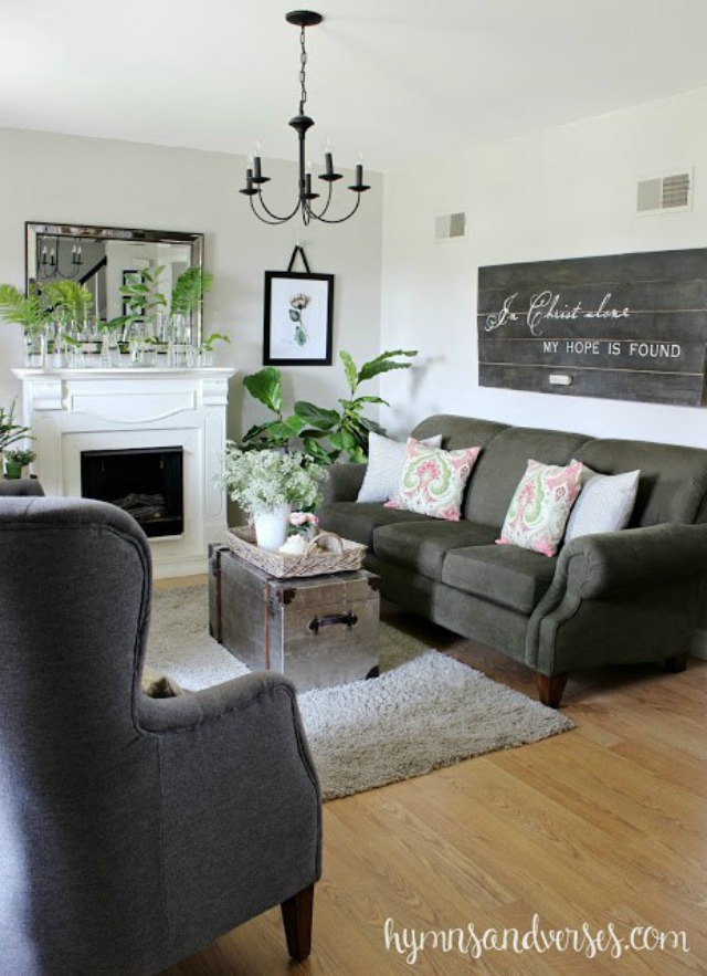Living room with gray sofa and chairs - love the reclaimed wood sign kellyelko.com