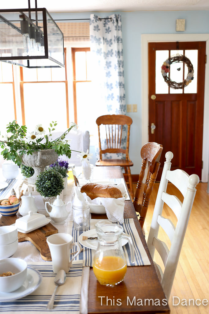 Farmhouse dining room - love the mismatched chairs and industrial chandelier kellyelko.com