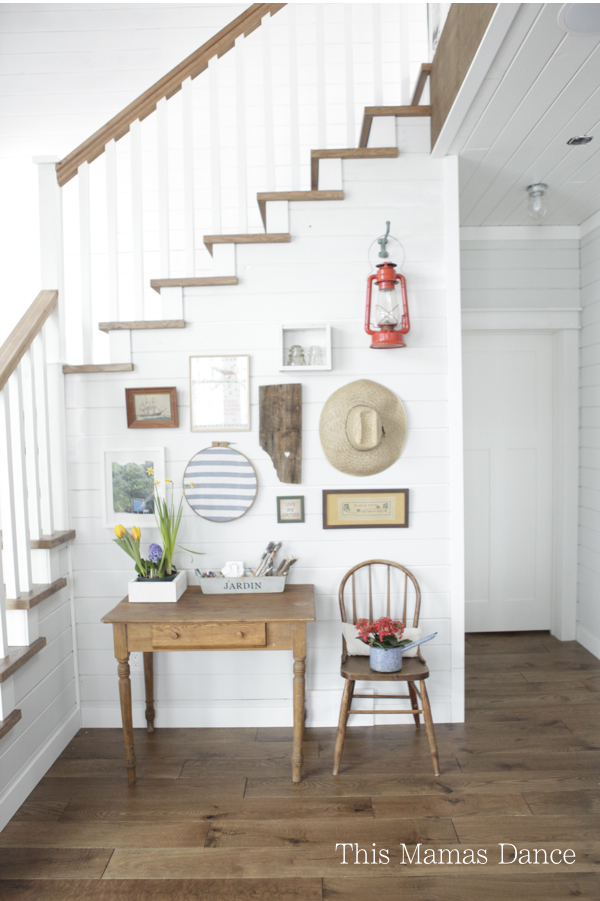 Farmhouse foyer gallery wall - love the mix of art and unique finds kellyelko.com