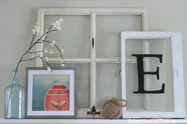 Lean antique windows on a mantel for a fun spring look kellyelko.com