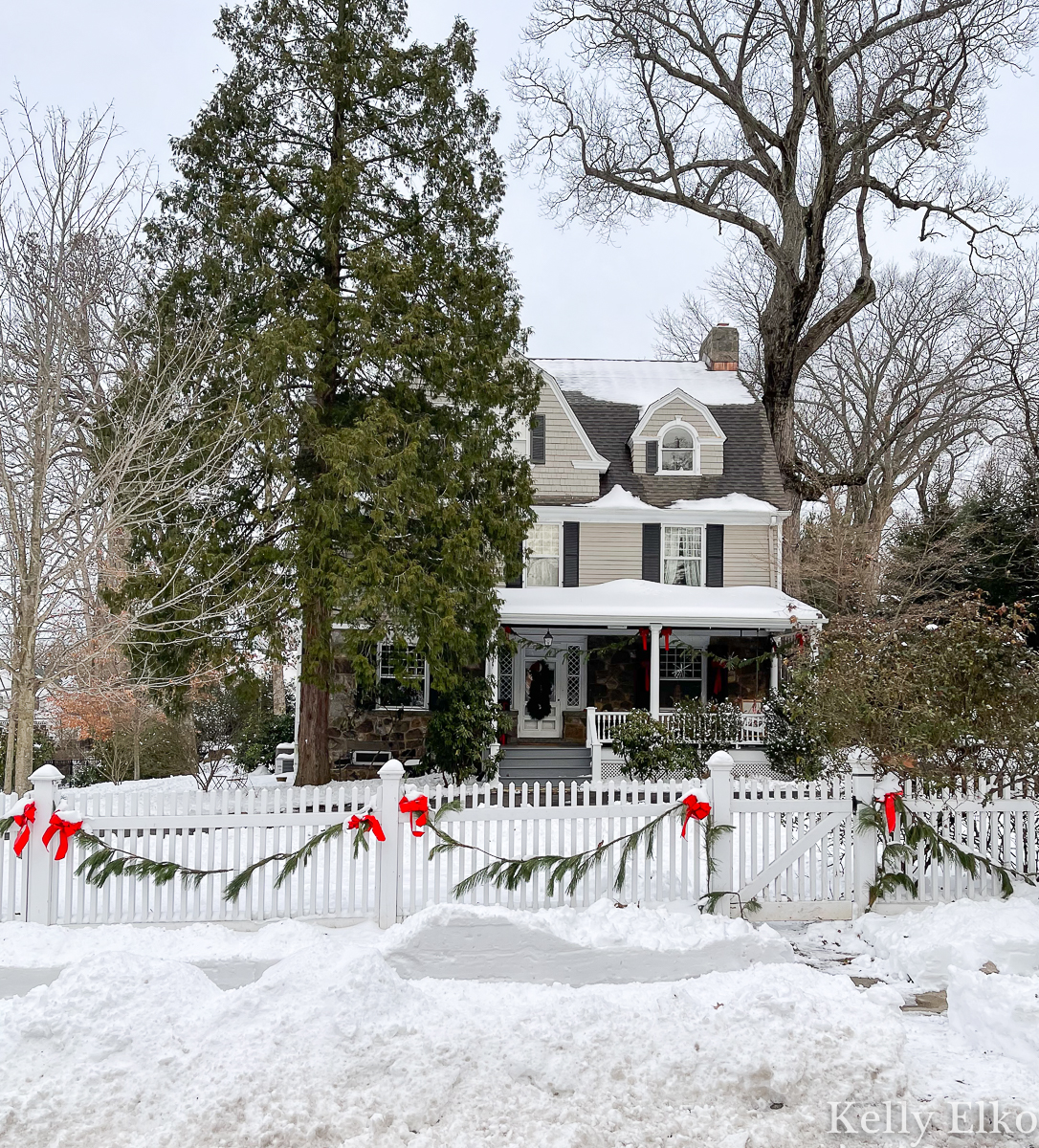 Love this beautiful snow covered old house and picket fence with garland kellyelko.com