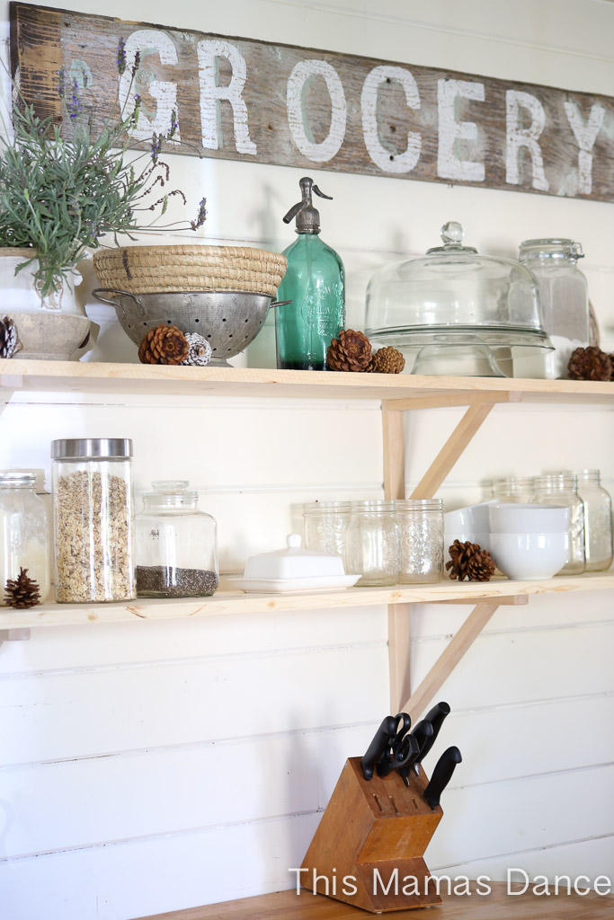 Open kitchen shelves and love the rustic wood grocery sign kellyelko.com