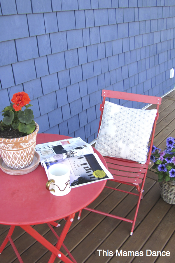 Cute red bistro set looks great against the blue house kellyelko.com