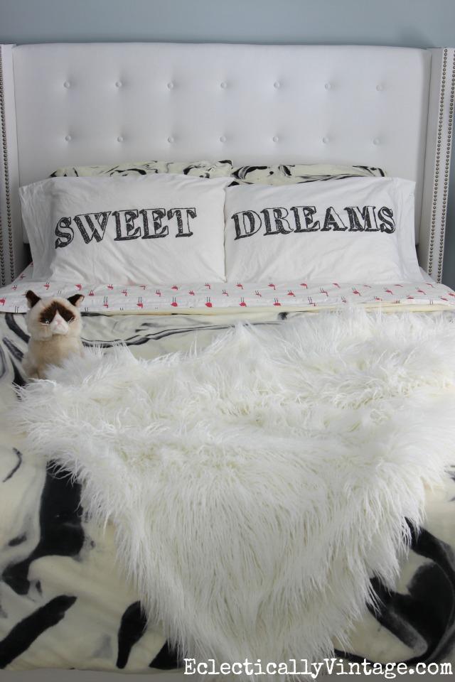 Tufted white headboard with fun pillowcases kellyelko.com