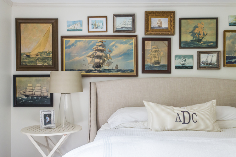Love this vintage painting gallery wall over a bed kellyelko.com